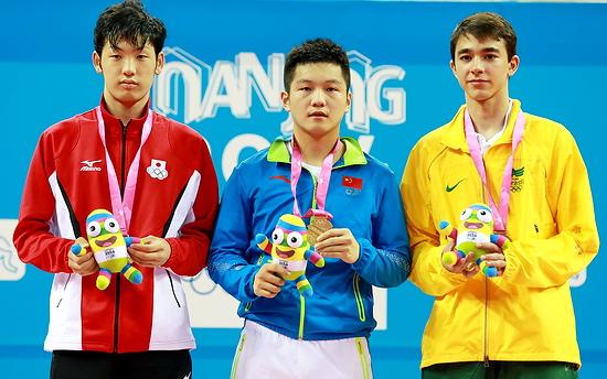 Призеры индивидуального разряда (слева направо): Muramatsu Yuto (Япония), Fan Zhendong ( Китай), Calderano Hugo (Бразилия) Фото - Sebire Marie / ITTF / flickr.com.